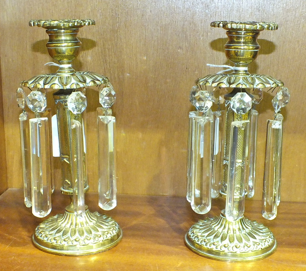 Lot 147 - A pair of brass chenets, each candle sconce above a leaf-moulded disc with cut-glass drops, 20cm, (
