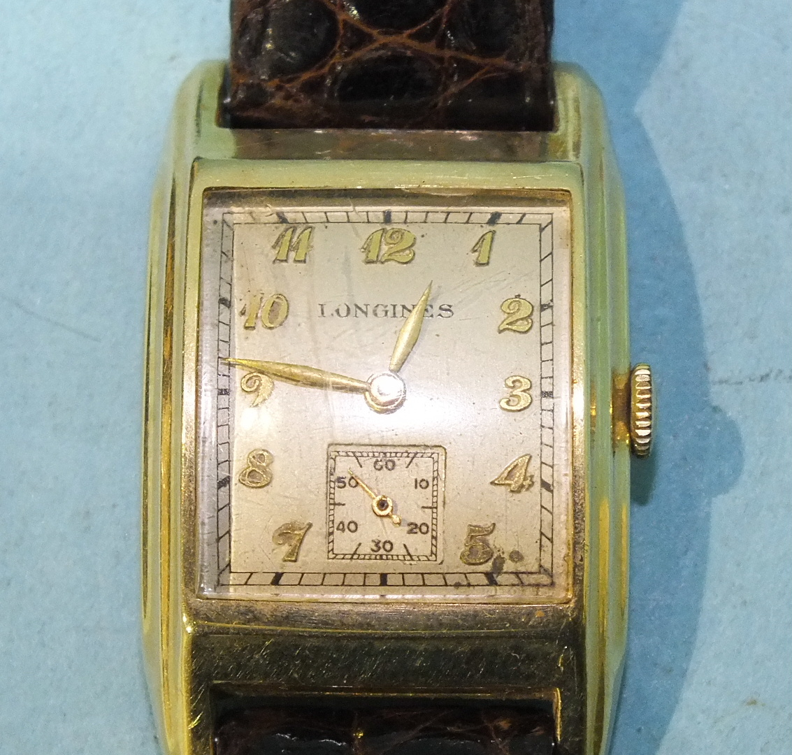 Lot 317 - Longines, a gent's 14ct gold tank watch on leather strap, boxed, (not working).