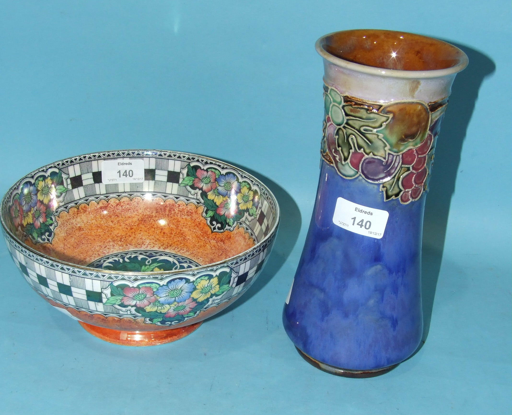 Lot 140 - A Royal Doulton stoneware vase of waisted form with tubeline decoration of fruit on a mottled