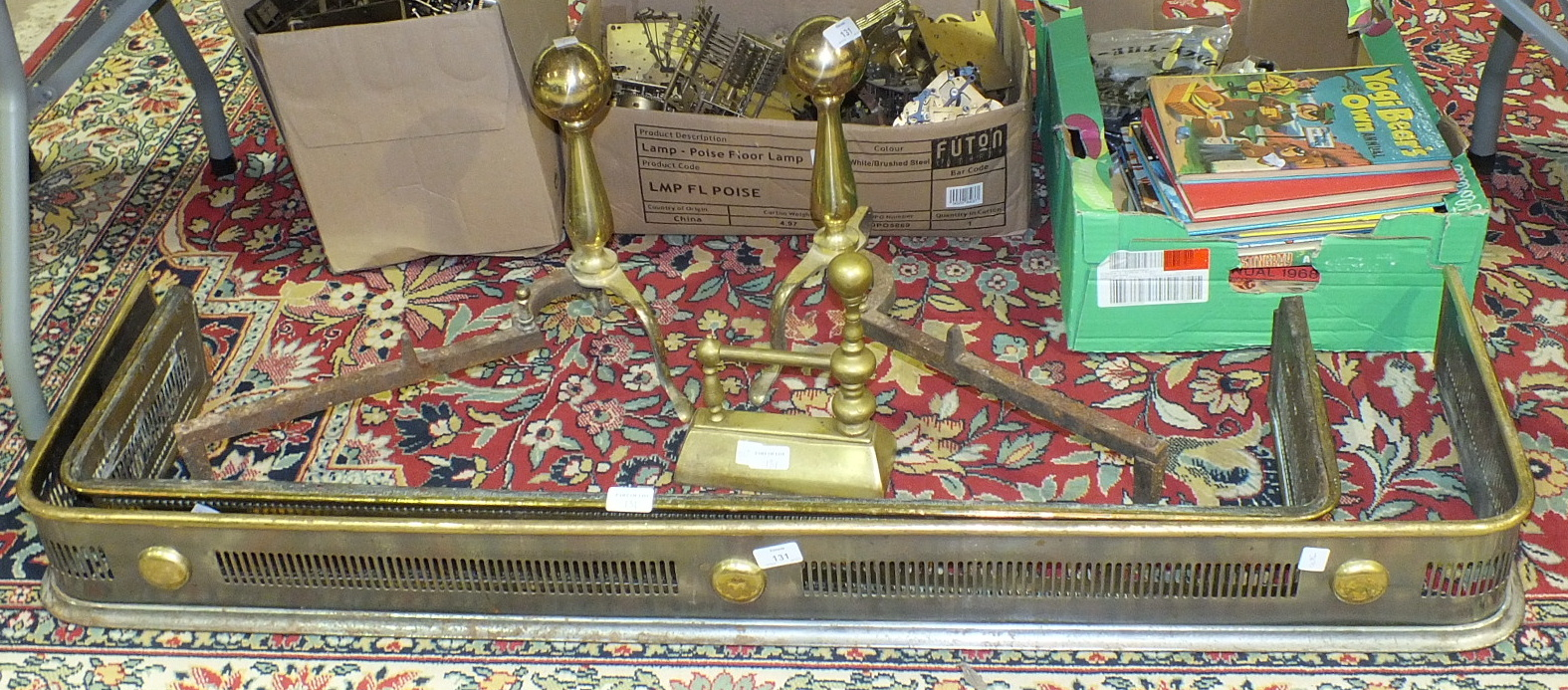 Lot 131 - A pair of brass fire dogs and two fire kerbs, 110cm and 130cm.