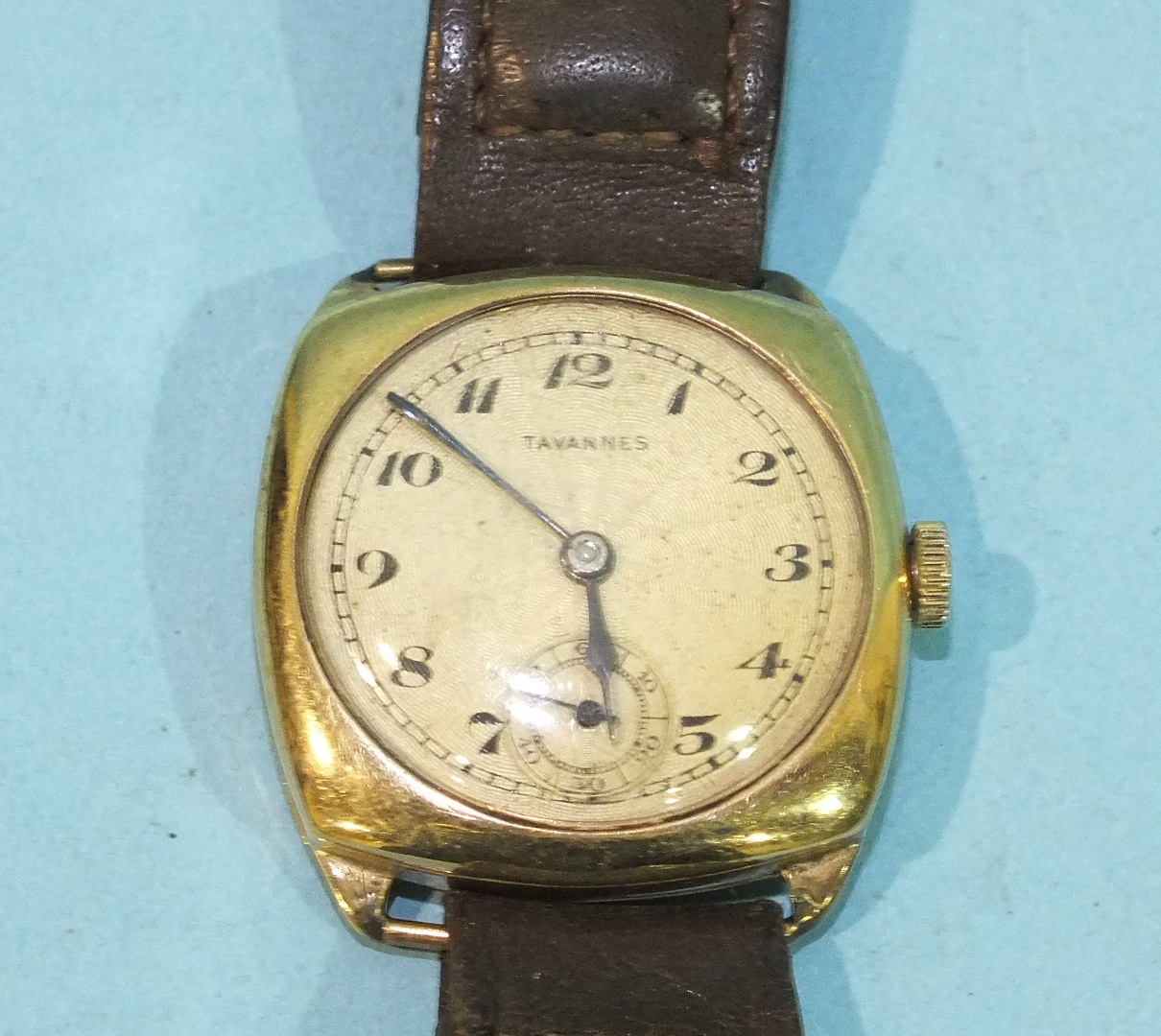 Lot 316 - Tavannes, a gents cushion-shaped 9ct gold-cased wrist watch, the movement numbered 287462, on