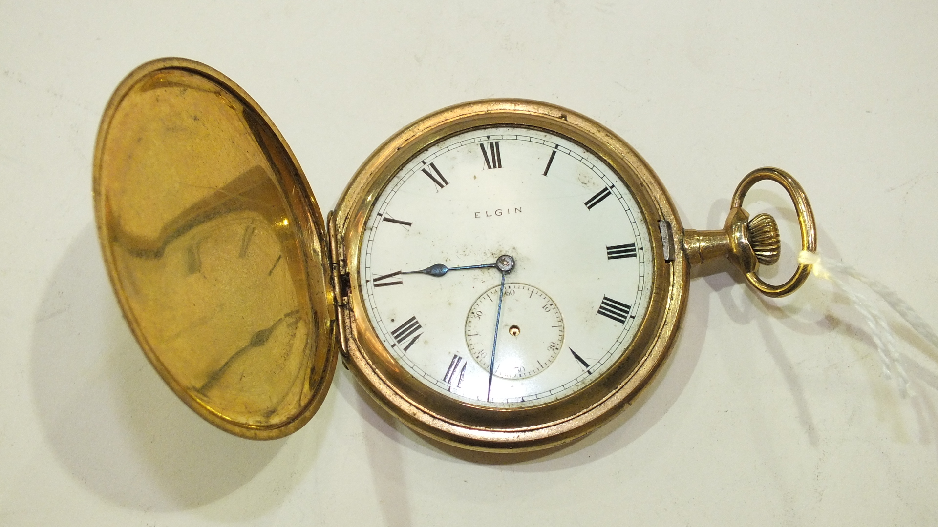 Lot 329 - An Elgin National Watch Co. hunter keyless pocket watch with gold-plated case, (a/f, not working).