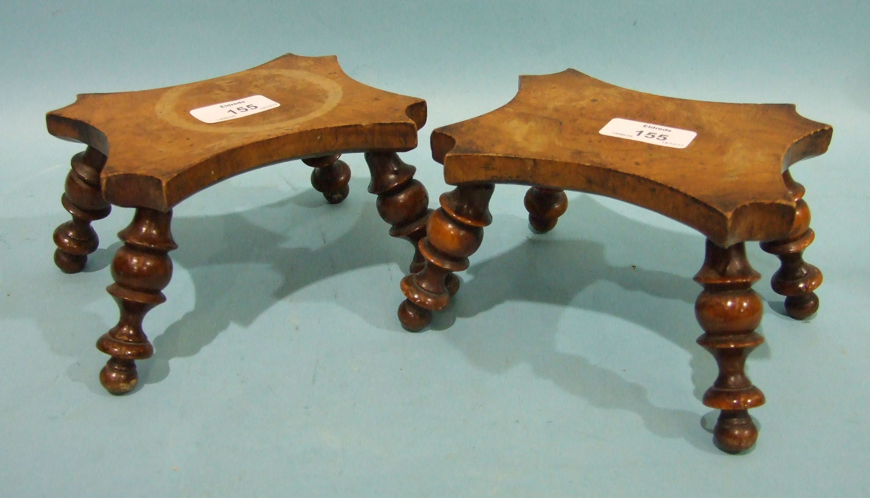 Lot 155 - A pair of burr walnut treen trivets, each concave shape top on four turned splayed legs, 16cm