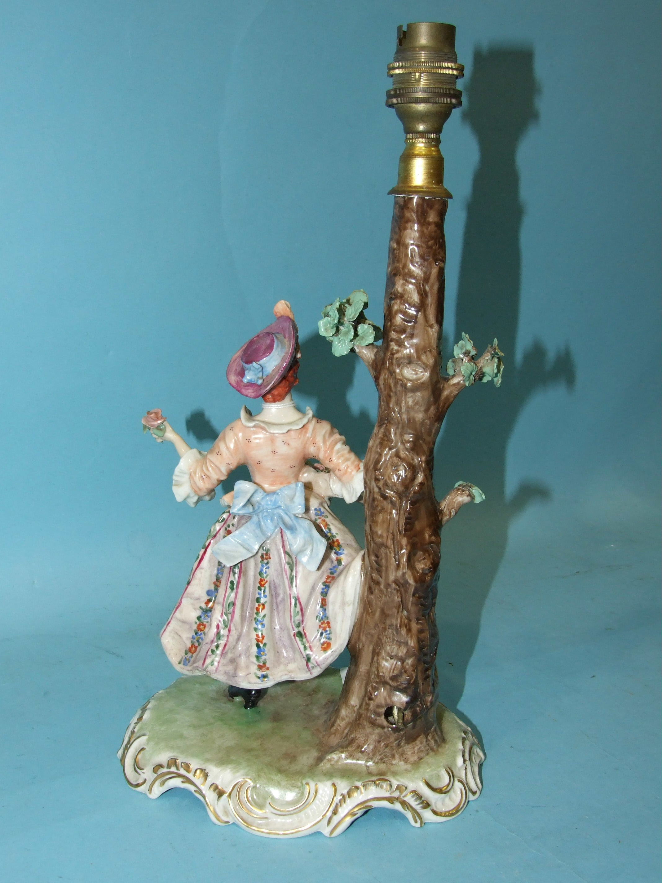 Lot 187 - A 20th century Naples porcelain table lamp in the form of a young woman, 39cm.