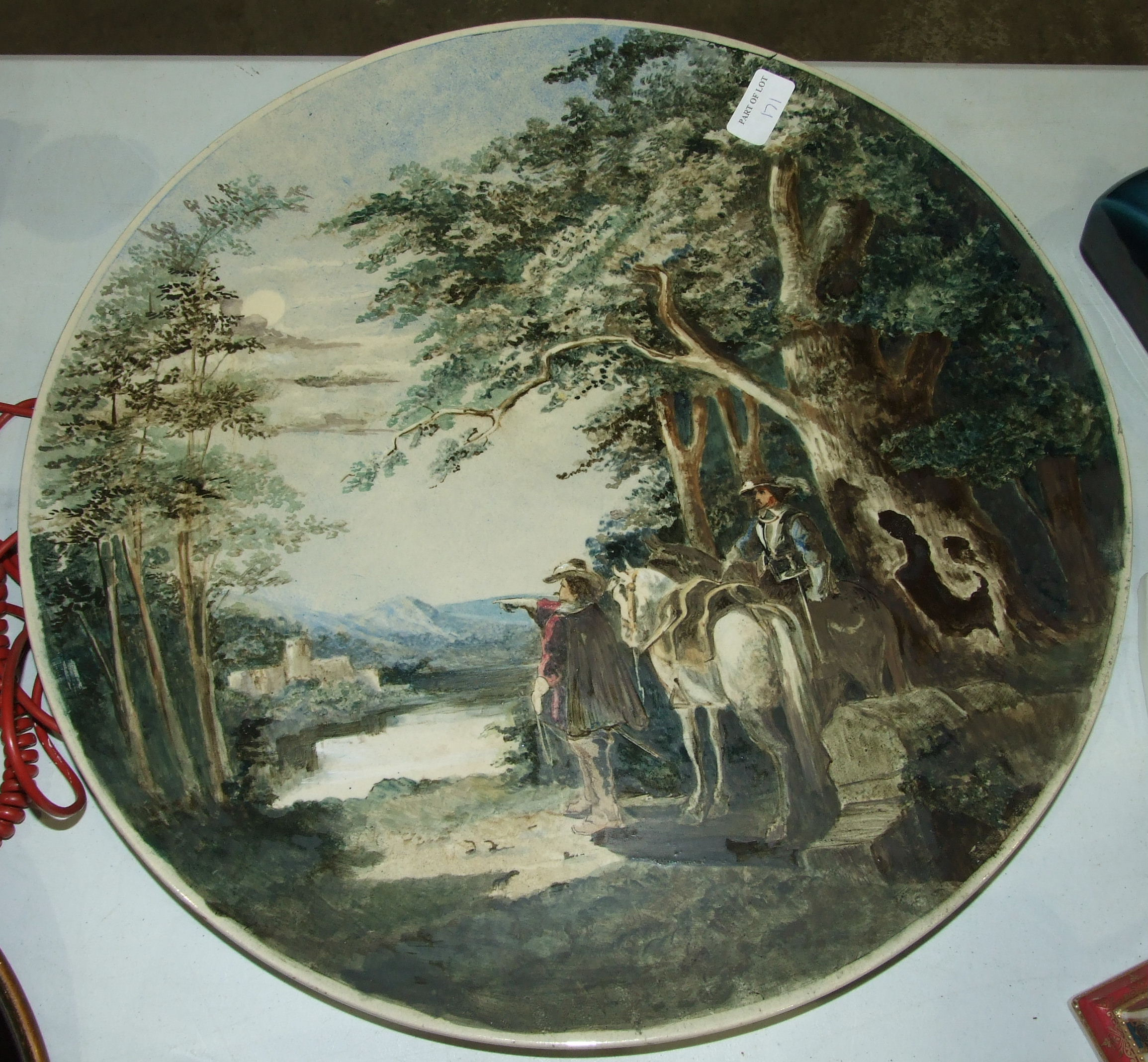 Lot 171 - A Musterschutz painted relief-decorated pottery plaque depicting monks in a wine cellar, 34cm
