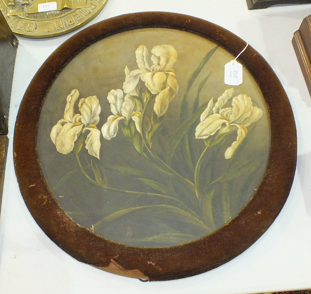 Lot 202 - A large terracotta plate painted with yellow Irises, 40cm diameter, in circular velvet-covered