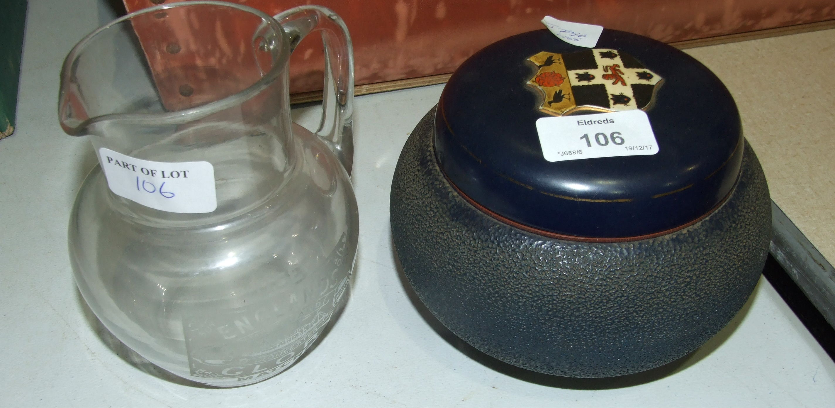 Lot 106 - A Carlton Ware ceramic tobacco jar made for SH Jones, Oxford and various other smoking accessories.