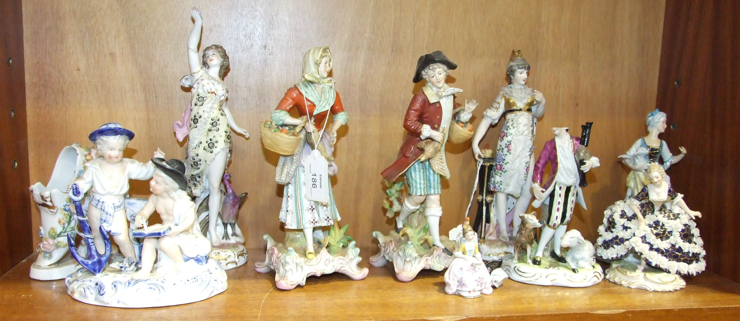 Lot 186 - A collection of 19th century Continental porcelain figures, (numerous damages).