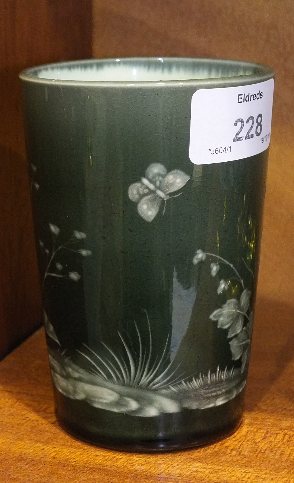 Lot 228 - A 19th century English ceramic beaker with etched decoration of a butterfly amongst a foliate