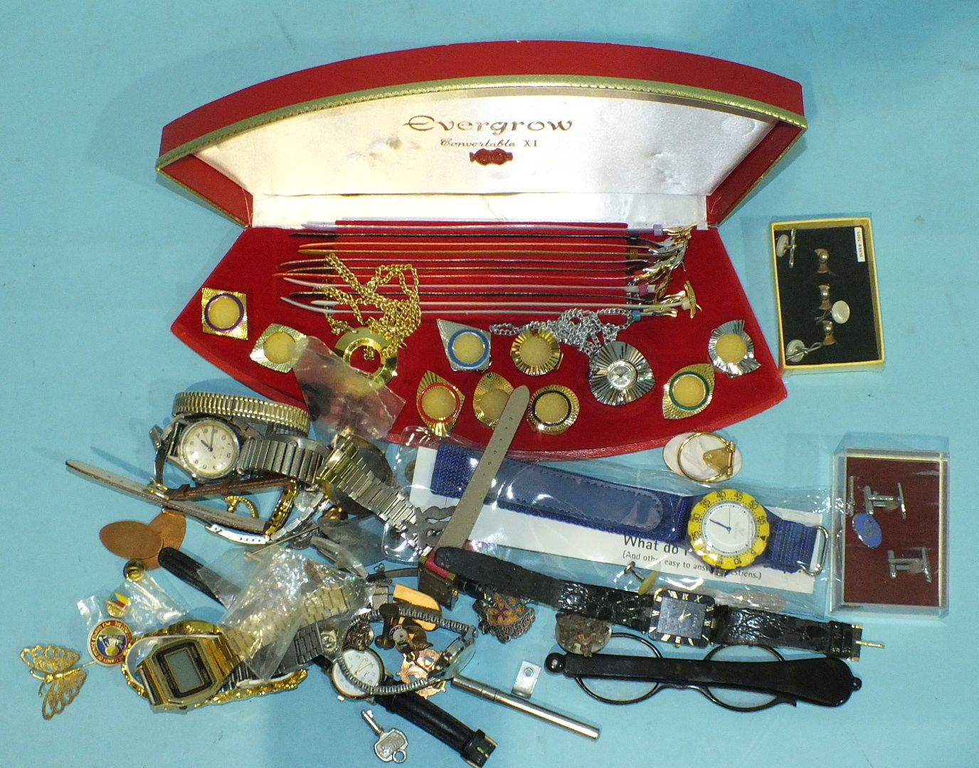 Lot 240 - An Evergrow Convertable XI set of watch straps, bezels and movement and other watches, badges, etc.