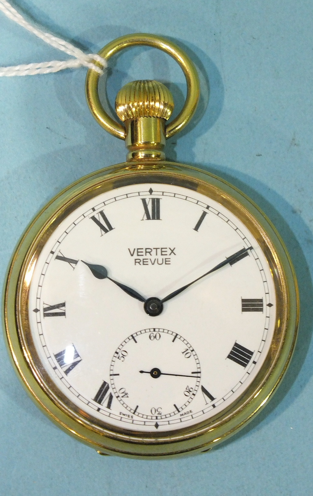 Lot 308 - A Vertex Revue open face keyless pocket watch with gold plated case.