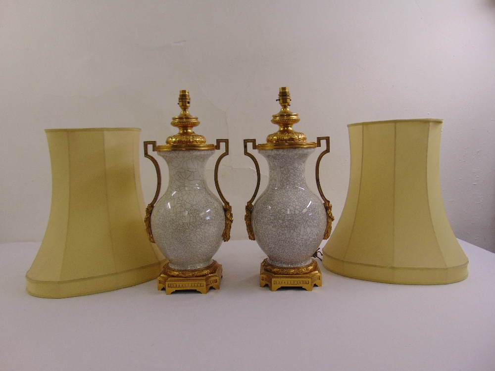 Lot 39 - A pair of porcelain cracked glazed vases with ormolu mounts converted to table lamps to include silk