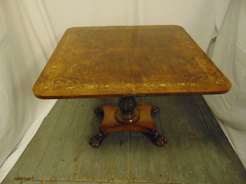 A late Victorian rectangular walnut and mahogany games table on quatrefoil base with claw feet - Image 2 of 2