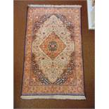 A Persian wool carpet, red and blue ground central medallion within organic and stylised geometric
