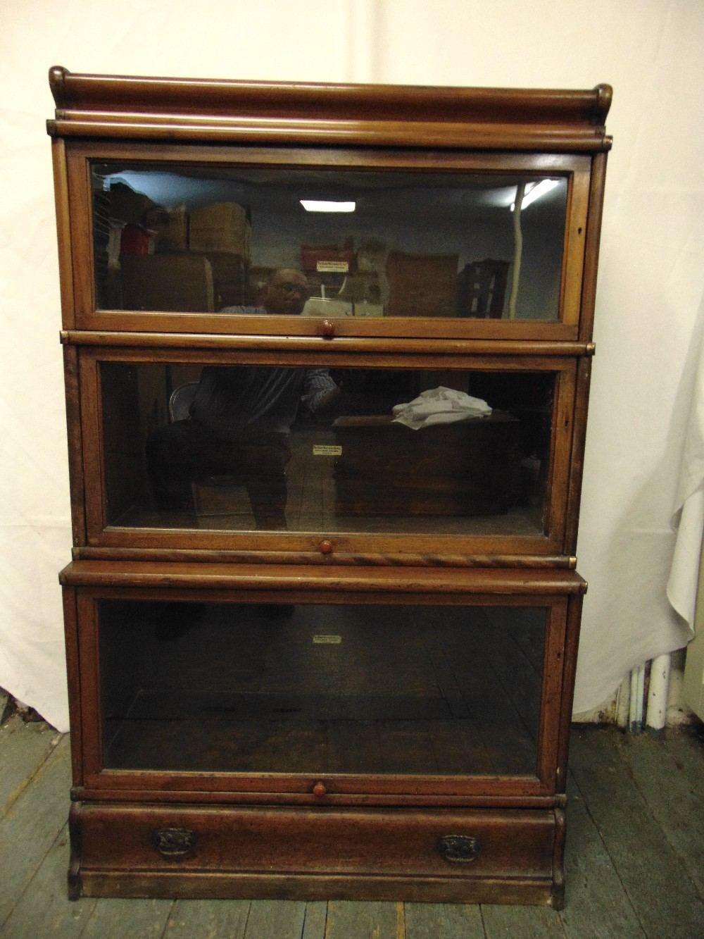Globe Wernicke three section glazed bookcase with single base drawer section and top plinth