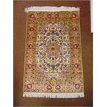 A Persian silk and wool carpet, brown green and blue with stylised natural and geometric forms