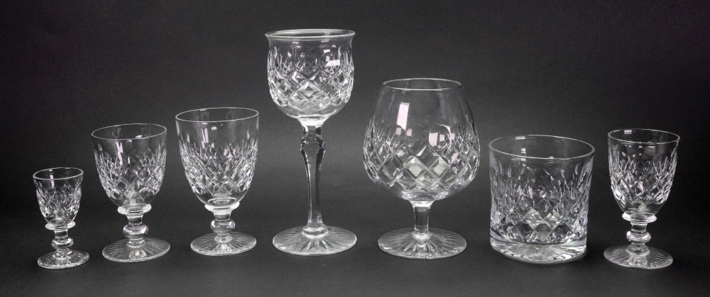 Lot 40 - A suite of Tudor facet and diamond cut glassware, with star cut bases, 90 pieces,