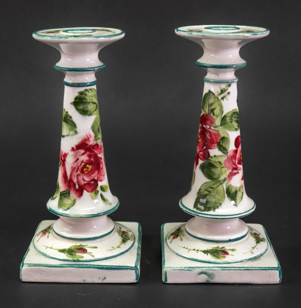 Lot 38 - A pair of Wemyss earthenware candlesticks, circa 1900, of tapered cylindrical form,