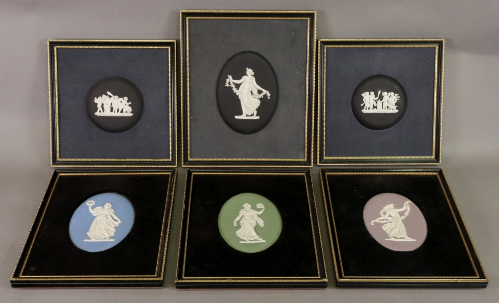Lot 37 - A set of four Wedgwood jasper dip oval classical plaques, each 12 x 8.