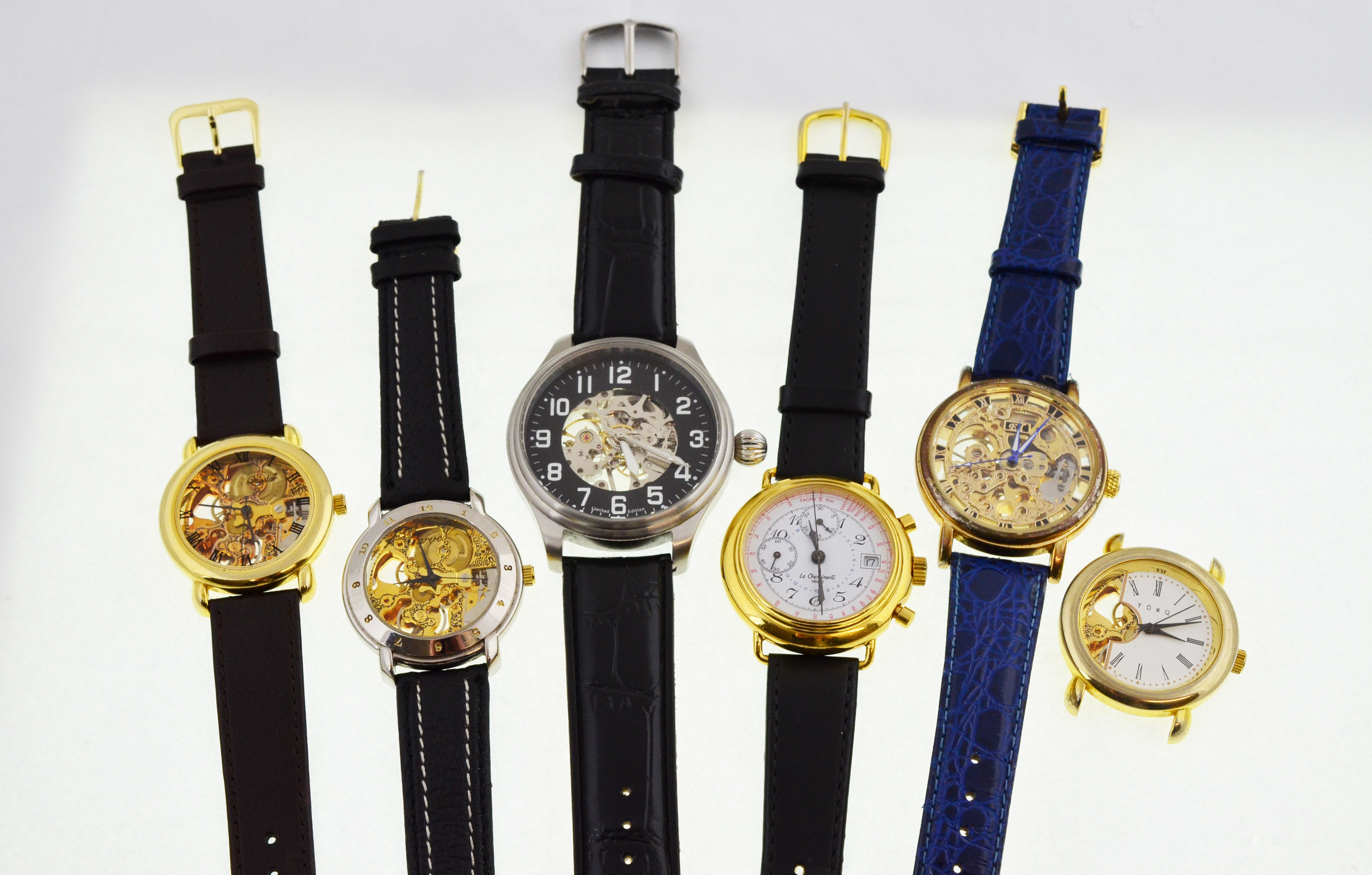 Lot 28 - Six modern skeleton mechanical wristwatches,