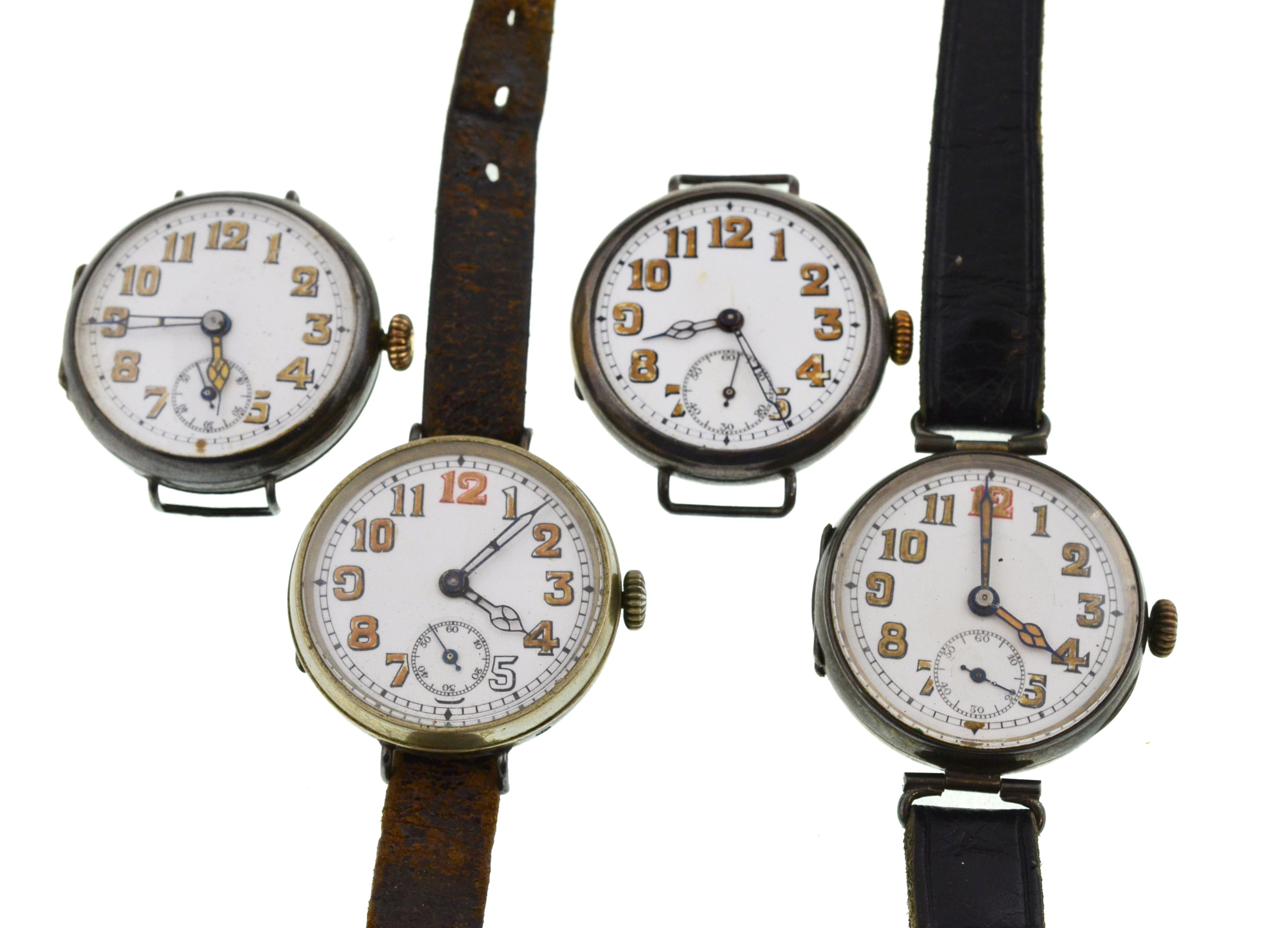 Lot 32 - Four early 20th century mechanical silver watches, all with uncracked white enamel dials,