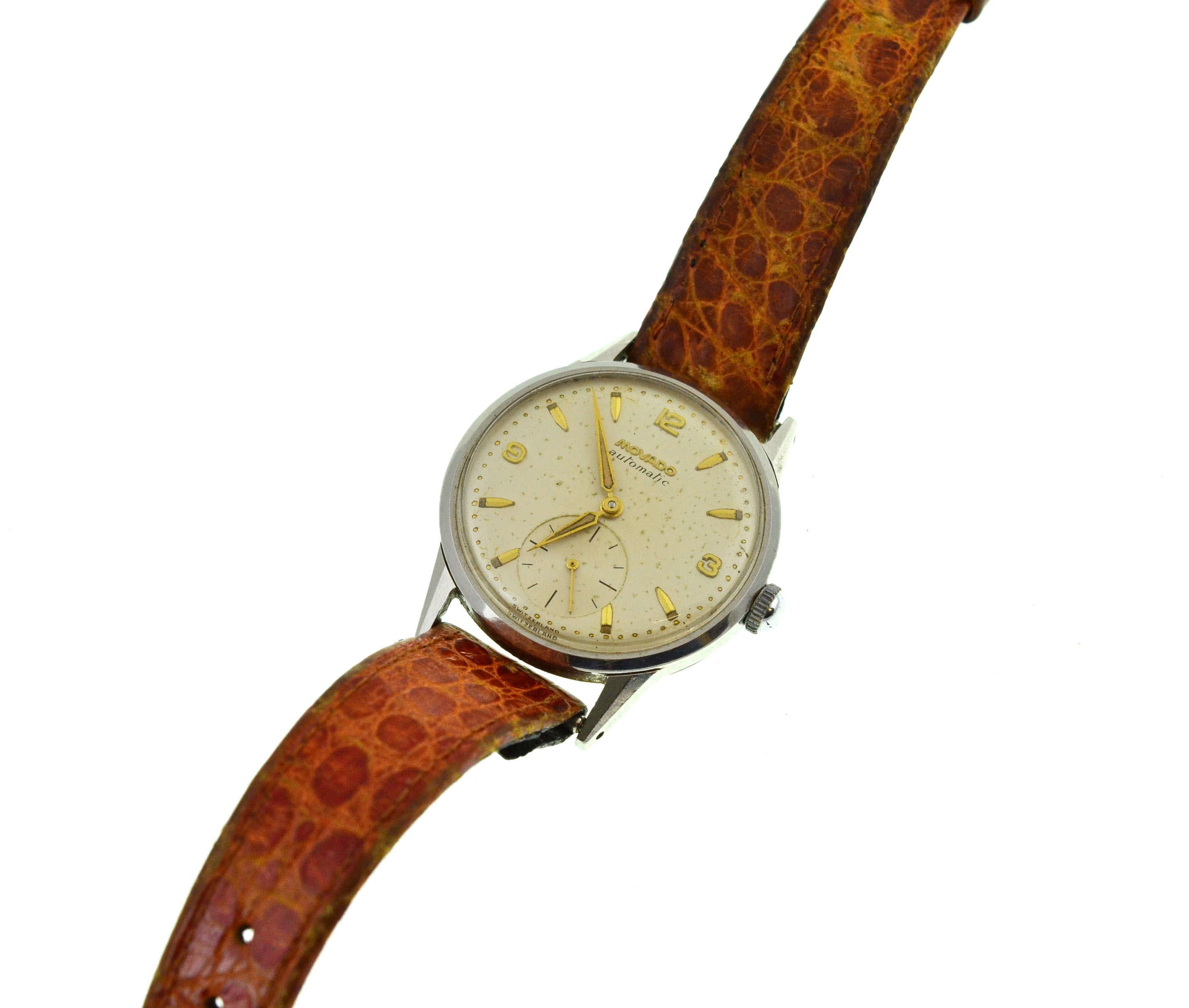 Lot 4 - A circa 1950's Automatic Movado steel wristwatch, approx 32mm, moisture marks to silvered dial,