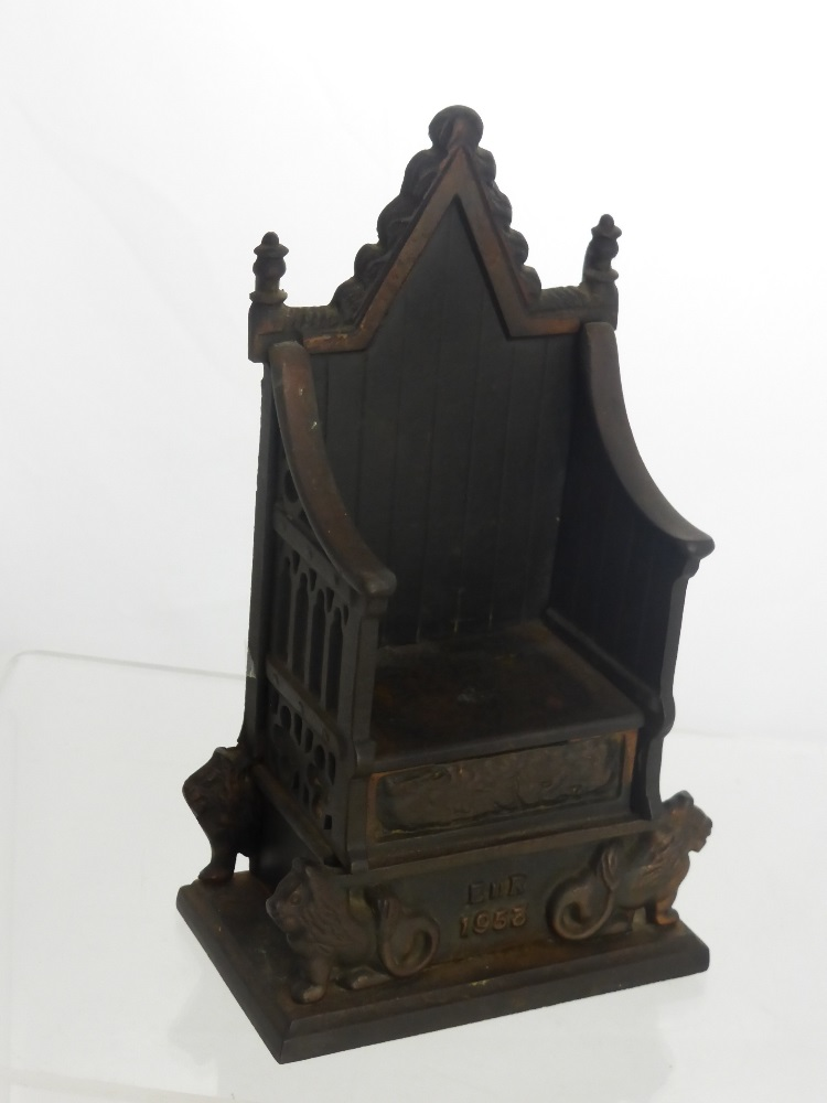 A Harper Cast Iron Money Box In The Form Of A Throne Dated