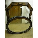 Lot 129 - An oak framed octagonal wall mirror,