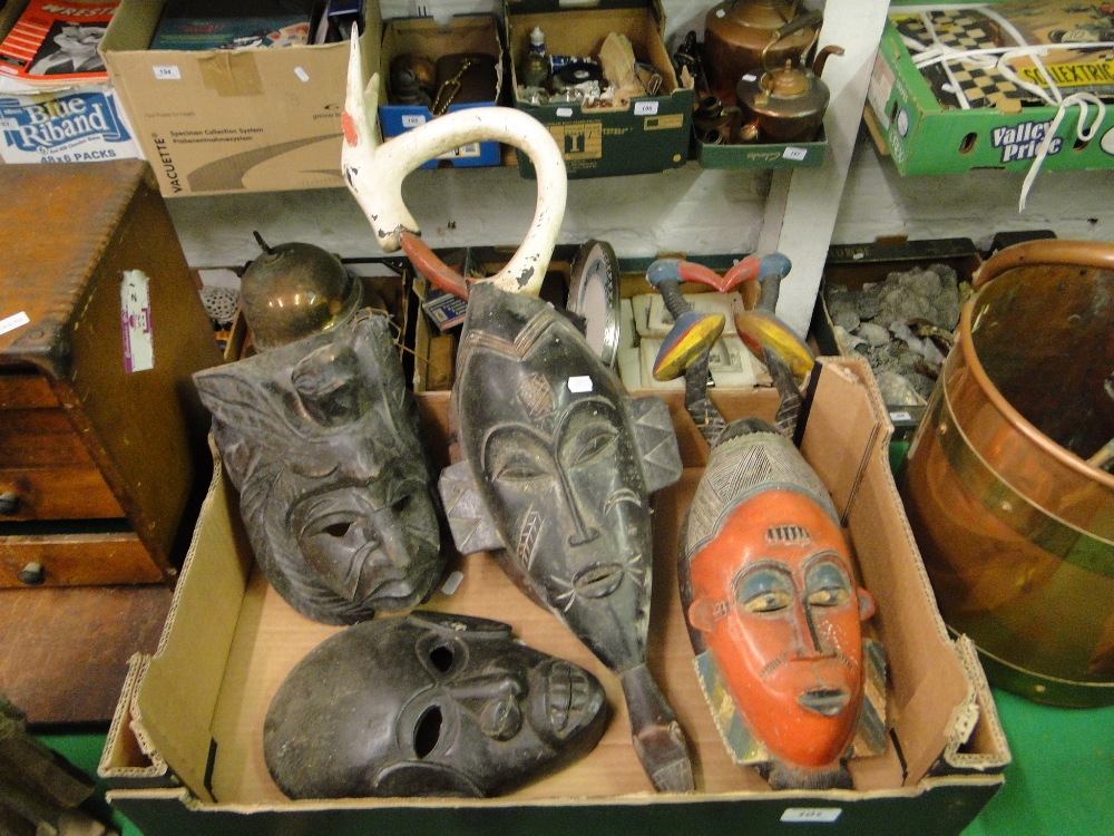 Lot 101 - 2 carved & painted African masks,