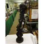 "Lot 76 - A Songwe carved wood Tribal fertility figure, height 32""."