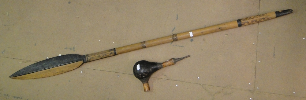 Lot 39 - An African pipe & an African wooden ceremonial spear (2)