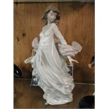 Lot 417 - A large Lladro figure - girl with a basket of flowers