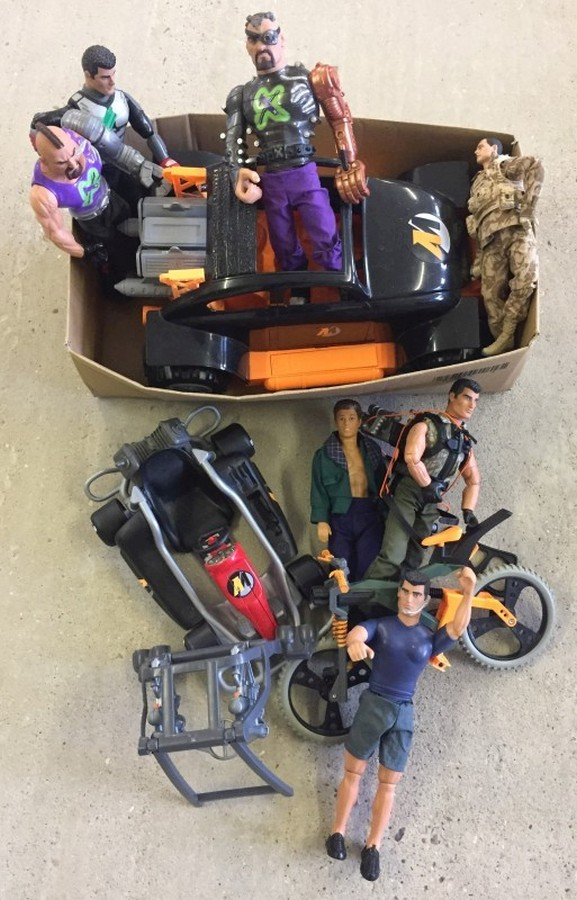 Lot 12 - A box of modern Action man figures and accessories.