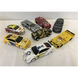 8 unboxed Scalextric slot cars.