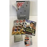 A collection of 007 James Bond magazine with collectors cards.