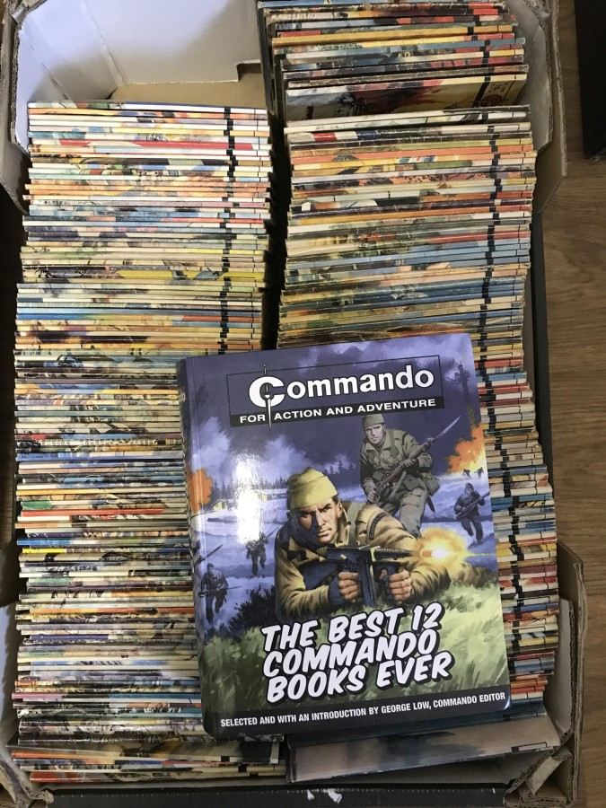 Lot 29 - A box containing a large quantity of Commando war books.