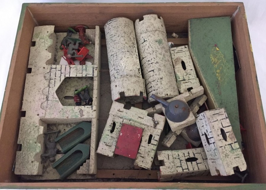 Lot 13 - A c.1920/30's wooden toy soldier castle and assorted plastic soldiers.