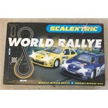 A boxed Scalextric World Rally, with Renault Megane cars.