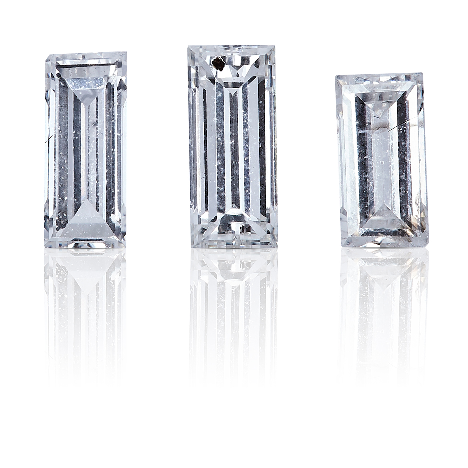 THREE BAGUETTE CUT DIAMONDS, TOTALLING 0.53cts, UNMOUNTED.