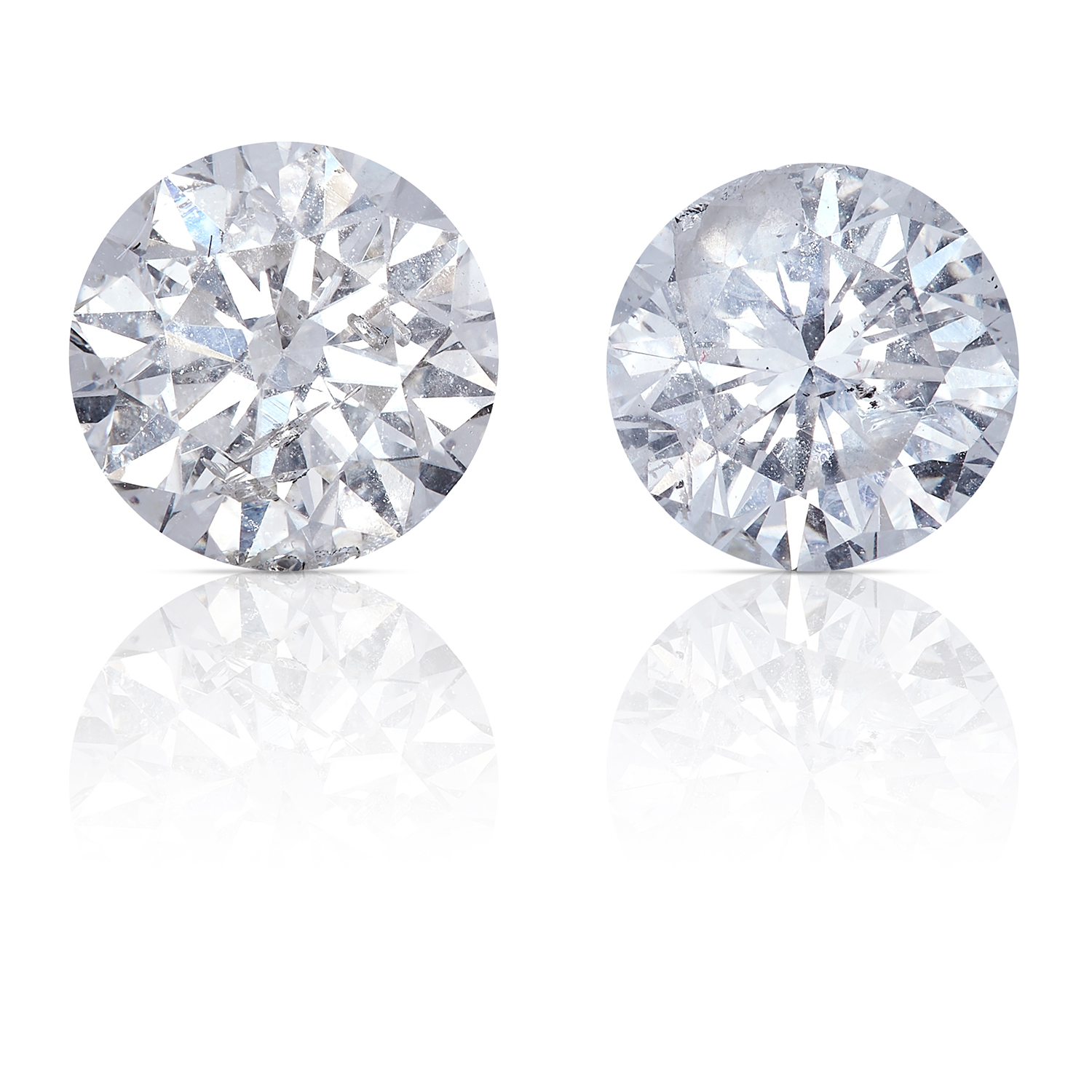 TWO ROUND CUT MODERN BRILLIANT DIAMONDS TOTALLING 1.56cts, UNMOUNTED.