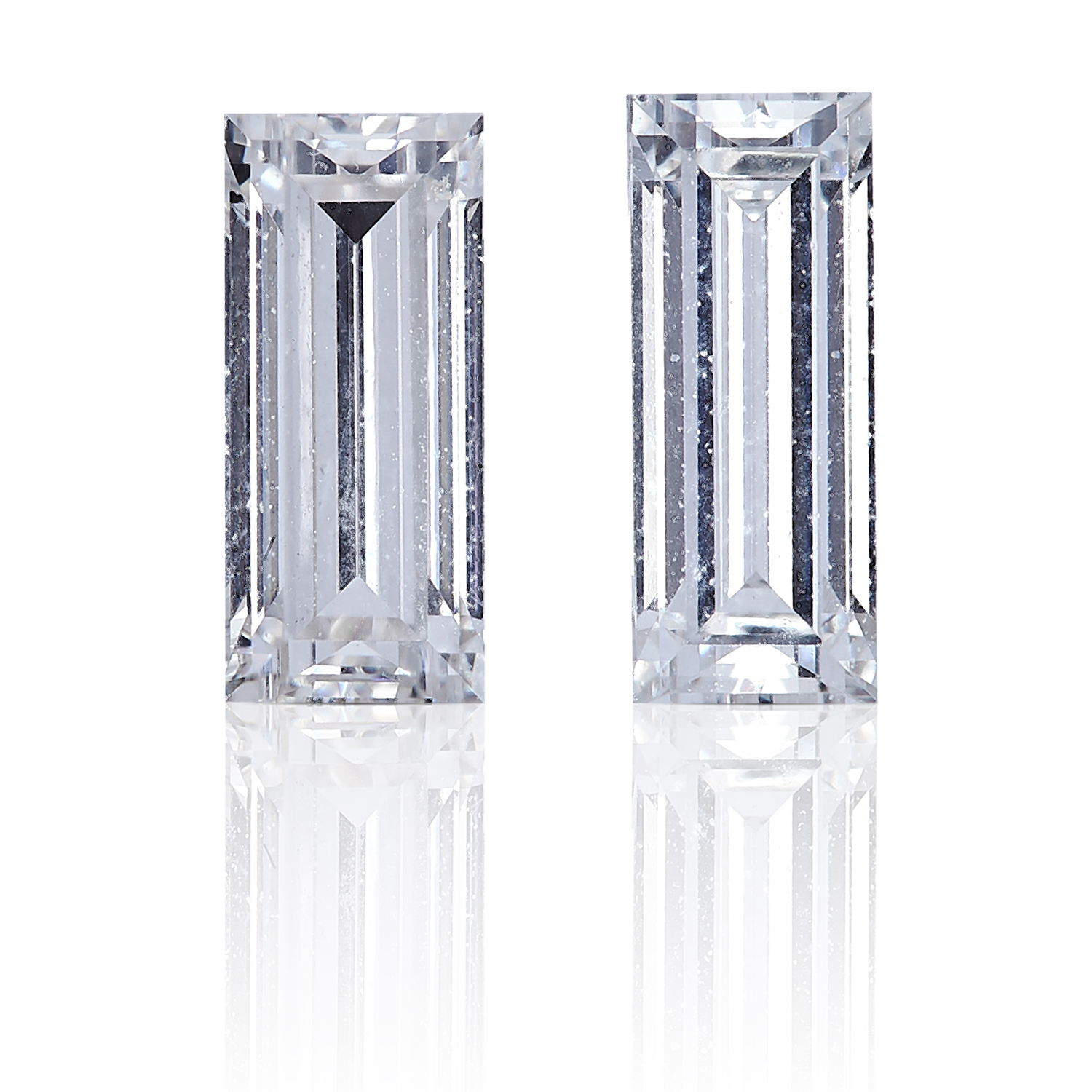 TWO TAPERED BAGUETTE CUT DIAMONDS, TOTALLING 0.59cts, UNMOUNTED.
