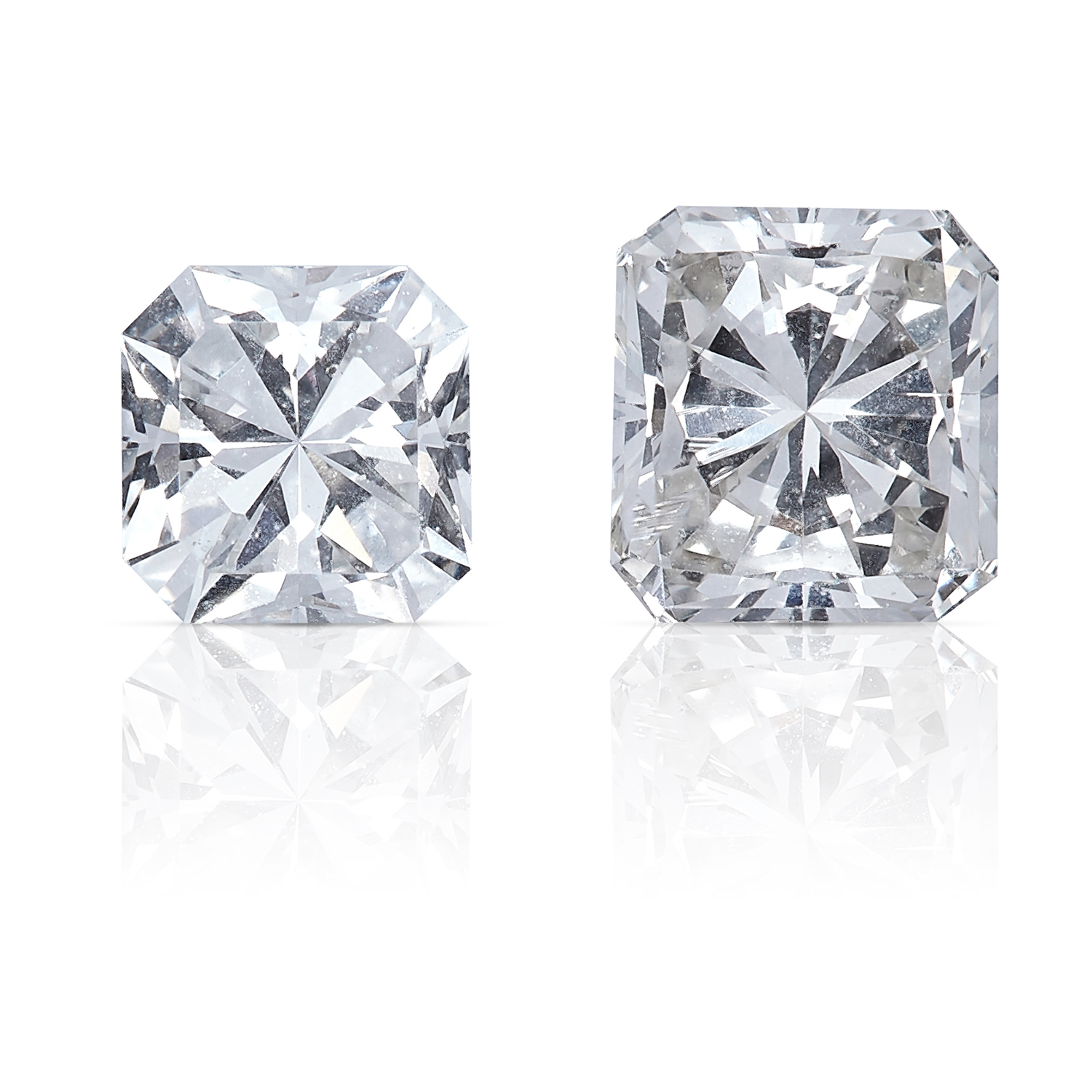 TWO SQUARE MODIFIED BRILLIANT CUT DIAMONDS, TOTALLING 0.71cts, UNMOUNTED.