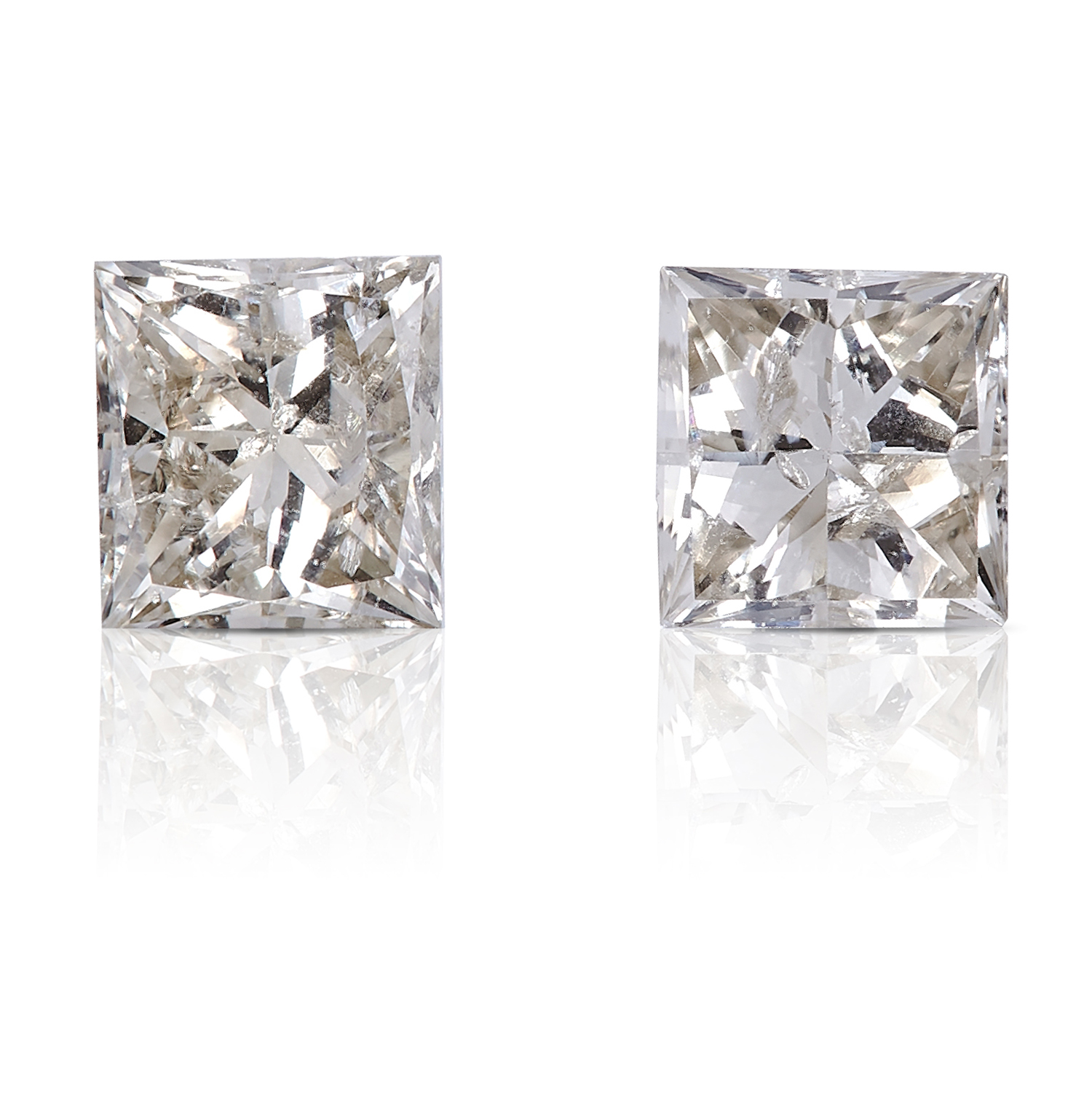 TWO SQUARE MODIFIED BRILLIANT CUT/PRINCESS, TOTALLING 0.55cts, UNMOUNTED.