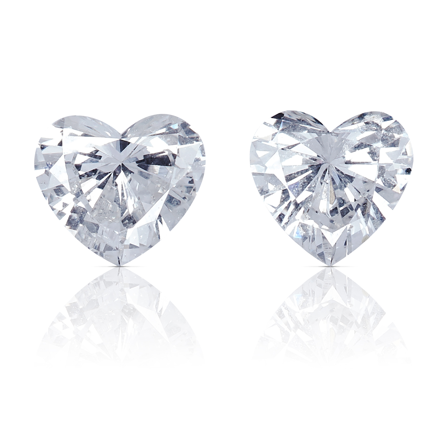 A PAIR OF HEART SHAPED BRILLIANT CUT DIAMONDS, TOTALLING 0.40cts, UNMOUNTED.