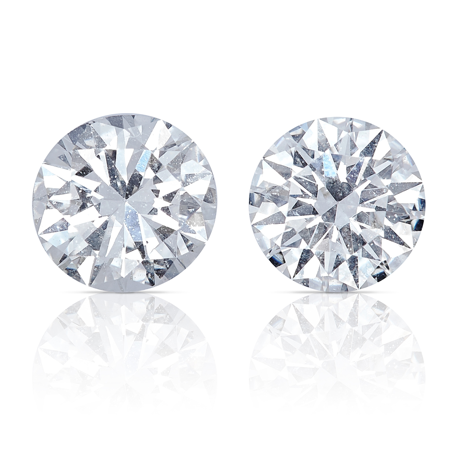 TWO ROUND CUT MODERN BRILLIANT DIAMONDS, TOTALLING 0.71cts, UNMOUNTED.