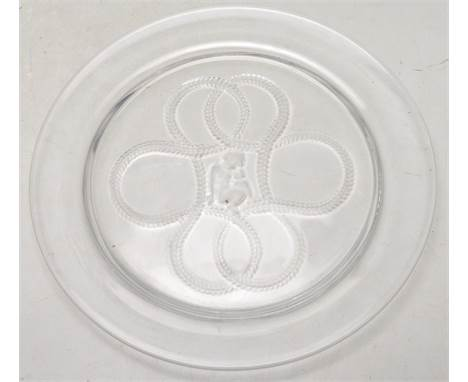 Lalique - A late 20th century vintage glass plate by Lalique of circular form having a central cherub with rope decoration ar