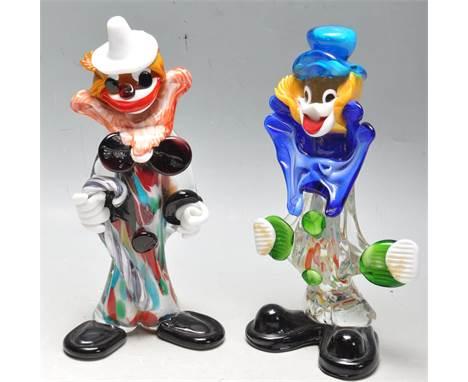 A pair of original retro 20th Century Italian / Venetian Murano studio glass clown figurines being decorated with multiples l