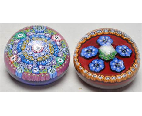 Two vintage late 20th century studio art glass Perthshire millefiori paperweights. One paperweight is dated 1995 having a P m