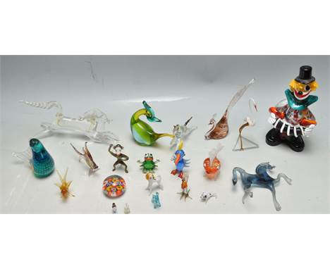 A large collection of 20th century studio art glass to include a several Murano pieces such as a clown figure and two bird fi