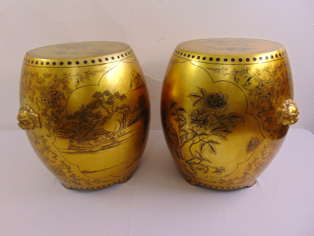 Lot 32 - A pair of oriental gold lacquered barrel shaped garden seats decorated with floral and leaf